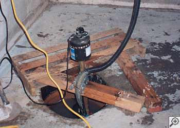 A Milton sump pump system that failed and lead to a basement flood.