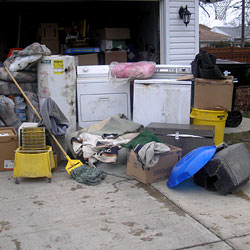 Soaked, wet personal items sitting in a driveway, including a washer and dryer in Panama City.